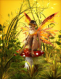 The Magical Fall. A little fairy is sitting on a fly agaric Stock Photo