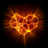 Magical fiery heart. On black background Stock Image