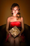Magical gift. Portrait of beautiful smiling relaxed young blond with magical gift box Royalty Free Stock Images