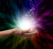 Magical Healing Energy. Healer's hand outstretched into magical healing energy field with sparkles Royalty Free Stock Photography