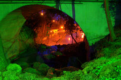 Magical illuminated rockery and a tunnel in a park Royalty Free Stock Image
