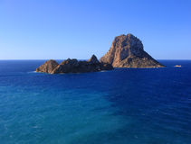The magical island of Es Vedra. The beautiful little island of Es Vedra in Ibiza (Spain), well known by its numerous UFO sightings and other paranormal phenomena Stock Photos