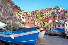 Magical landscape with boats on the streets of Manarola in Cinque Terre, Liguria, Italy, Europe.  stock photo