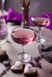 A magical lilac drink in a mysterious evening setting. Spiritual magic background royalty free stock photography
