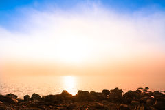 Magical morning with the sun and the fog in front Stock Photo