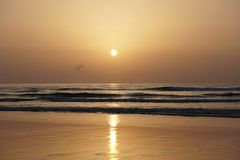 Magical ocean. Sunrise over the Atlantic. Morning. Waves of the surf. Beach Stock Photos