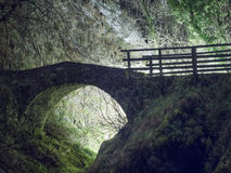 Magical old bridge,by night,  light behind. Ancient bridge. Eery, beautiful and rather mysterious Stock Image
