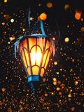 A Magical Old Street Lantern Shines on the Street at Night. Many bright lights around.. Vintage Old Street Classic Iron Lantern On. The House Wall. Christmas or stock images