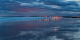 Magical panorama seascape reflection town water. In shades of blue. Stock Images