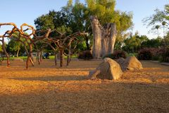 "Magical playground. Jungle gym, boulders and towering tree stump at ""Vinehenge"", a creative, innovative theme-based playground at Grape Day Park in stock photo"