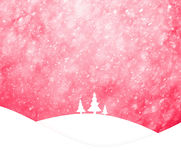 Magical red colored sky with realistic heavy snowfall landscape Stock Images