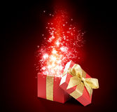 Magical red gift. With golden ribbon and bow Royalty Free Stock Images