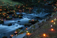 Magical river at night. Lit by red and yellow candles Stock Photos