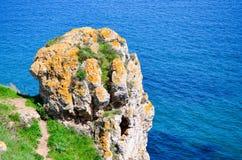 Magical rock over the sea Stock Photos