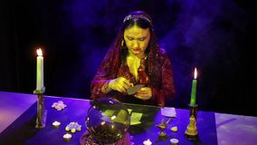 In the magical salon gypsy lays out the cards on the table in the glare. The average plan stock footage