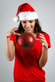 Magical santa girl floats a christmas ball Stock Images