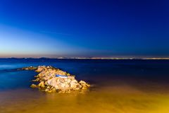 Magical Seaside After Sunset With Princess Islands On Horizon - Turkey. View of Princess Islands from the shoreline of Cinarcik town which is the district of Stock Photo