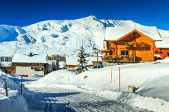 Magical ski resort in Alps,La Toussuire,France,Europe. Stunning winter panorama with snowy road and village,La Toussuire,France,Europe Stock Photos