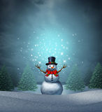 Magical Snowman. Winter holiday as a merry christmas and happy new year greeting card with a cute happy snow character with glowing  northern lights snowflake Royalty Free Stock Images