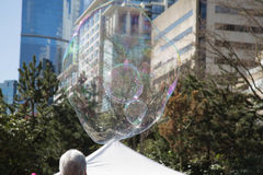 Magical soap bubble flying cityscape Stock Image