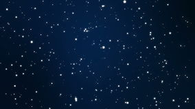 Magical sparkly particles flickering on a blue black background. Night sky full of stars fantasy animation made of magical sparkly light particles flickering on