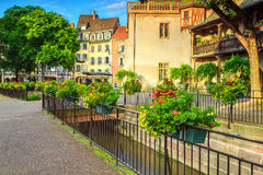 Magical street with colorful flower decoration in Colmar, France, Europe Stock Photo