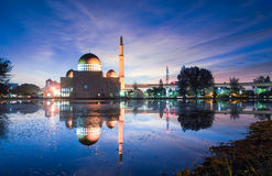 Magical sunrise at Masjid As Salam, Puchong. Magical sunrise at floating mosque, Masjid As Salam, Puchong with reflection on the water lake. Soft focus due to Stock Images