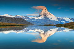 Magical sunrise with Matterhorn peak and Stellisee lake,Valais,Switzerland. Stunning sunrise panorama with Matterhorn and beautiful alpine lake,Stellisee,Valais Royalty Free Stock Photos