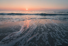Magical sunrise over the sea stock photos