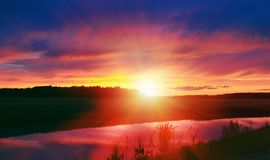 Magical sunset. At landscape with lake Royalty Free Stock Image