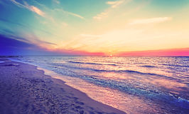 Magical sunset over Baltic Sea coast. Royalty Free Stock Image