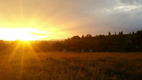 Magical sunset over countryside, zoom out stock footage