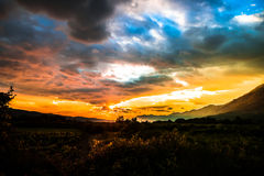 Magical sunset over a valley with mountains around Stock Photo