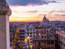 Magical sunset in Rome. From Trinità dei Monti, over the Spanish Steps and Via del Corso, the main shopping street of the Italian capital Stock Image