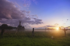 Magical sunset in rural areas, Green field and trees. Nature. Royalty Free Stock Photography