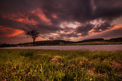 Magical sunset and thick clouds. Moravian landscape Podoli Royalty Free Stock Image