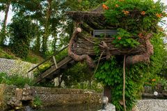 Magical tree house for relaxing or playing in the backyard. /garden stock image