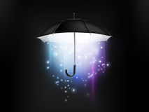 Magical umbrella. Magical glow coming from the umbrella on a dark background Royalty Free Stock Photos