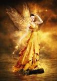 Magical ung kvinna som guld- fe Royaltyfri Bild