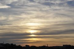 Gorgeous sunset strata cloudscape. Magical view of gorgeous sunset over cityscape stock photos