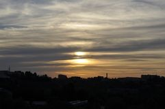 Gorgeous sunset strata cloudscape. Magical view of gorgeous sunset over cityscape royalty free stock images