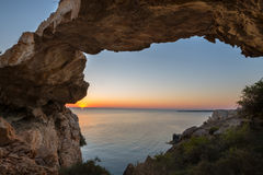 Magical view. Stone natural bridge during sunrise Stock Images