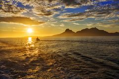 Magical view of the traveler to the sea:  sun at sunset,  mounta. Ins, fjord and ship. Norway Stock Photos