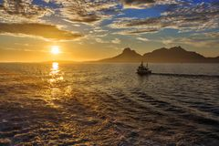 Magical view of the traveler to the sea:  sun at sunset,  mounta. Ins, fjord and ship. Norway Stock Photography