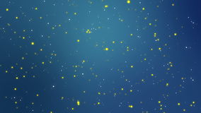 Magical white yellow particles flickering on a teal blue background stock video