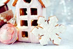 Magical winter christmas picture. Gingerbread house with snow. stock photos