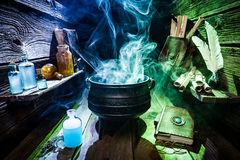 Magical witch workshop with blue and green smoke for Halloween Royalty Free Stock Photo