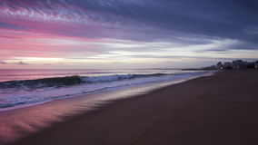 Magically pink sunset over the sea. Quarteira Algarve stock video footage