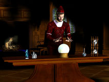 Magician. A magician sees a prophecy in his crystal ball Stock Photo