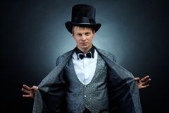 Magician. Image of male magician in hat and tail-coat looking at camera Stock Images